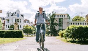 vamos Geschäftsführer Stephan Krug auf dem Fahrrad